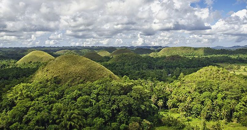 Mundo Hill on the island of Mindanao is the habitat of the critically endangered Philippine eagel. Not every hill here is covered in trees, but progress is being made.
