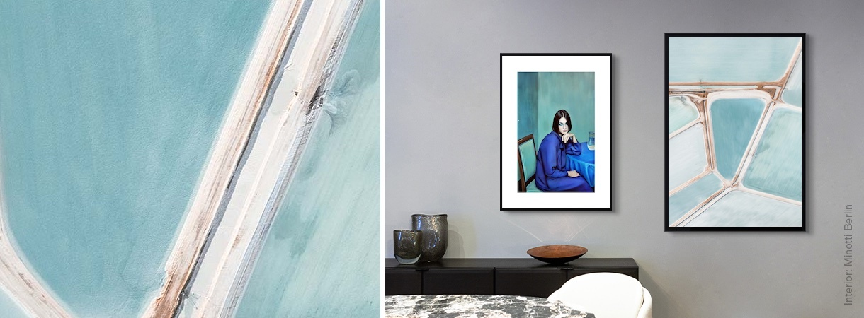 Artworks by Yakovlev and Aleeva and by Tom Hegen on a home wall